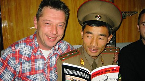 Andy with a border guard on board a train heading for Pyongyang