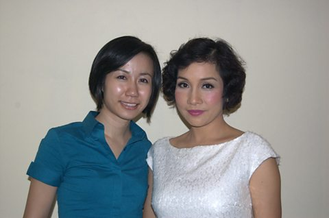Presenter Jennifer Pak with diva My Linh at Hanoi Opera House