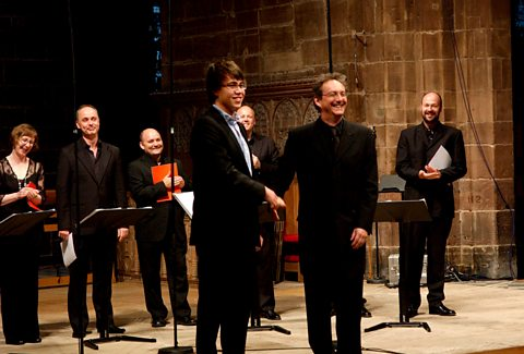 Owain Park, with members of The Tallis Scholars and conductor Peter Phillips