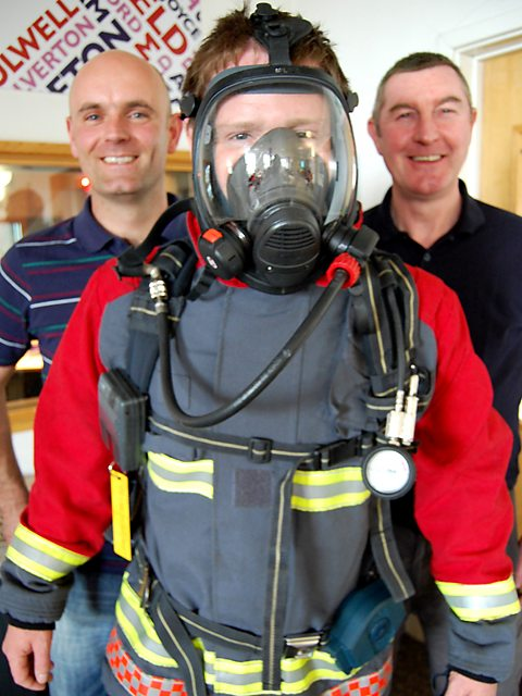 Richard 'kitted up' with firefighters Lee Newbold and Dave Needham 