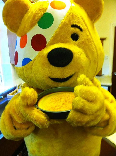 Pudsey helps in the kitchen