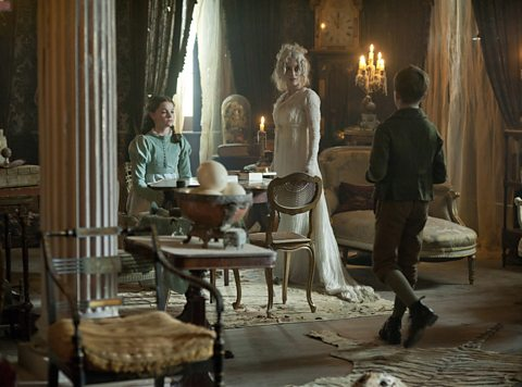 Miss Havisham (Gillian Anderson) invites Pip (Oscar Kennedy) to meet Estella (Izzy Meikle-Small)