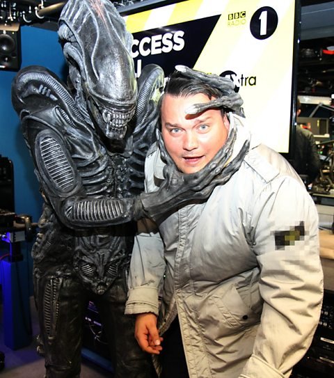 Charlie Sloth with a disgruntled alien
