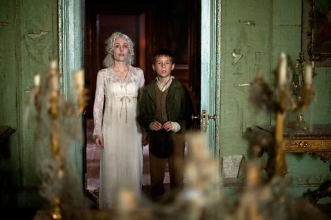 Young Pip (Oscar Kennedy) and Miss Havisham (Gillian Anderson)