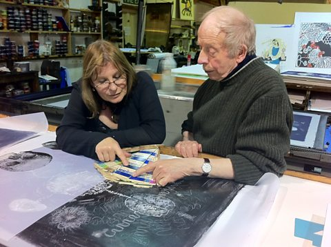 Susan Aldworth and Stanley Jones inspecting the lithographic print they are working on together