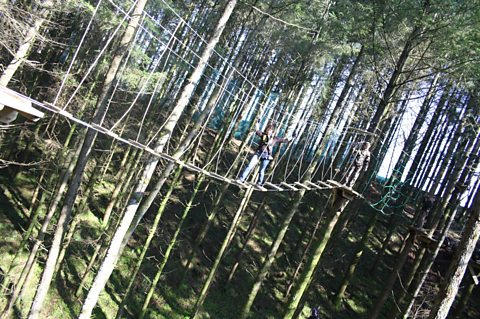 Helen crossing the rope bridge