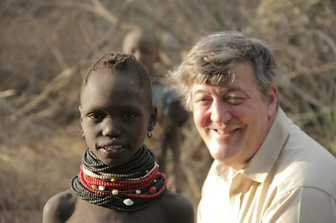 Stephen Fry with a Turkana child