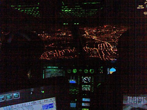 The view of the city from the cockpit at night