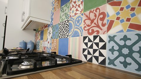 AFTER: THE TILES ADD A SPLASH OF COLOUR IN THE KITCHEN