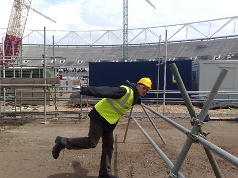 Stephen Chittenden crosses the site of the finish line in the 2012 Olympic stadium