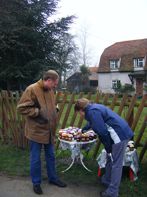 Clare and Sir Andrew Motion inspect the jam for sale