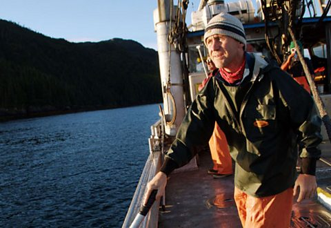 Arctic presenter Bruce Parry works on a salmon fishing boat in Prince William Sound, Alaska