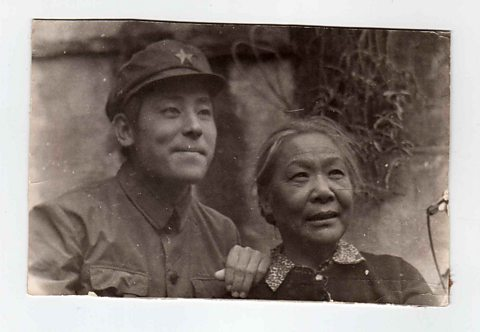 Guo Yue aged 17 in his People's Liberation Army uniform, with his mother