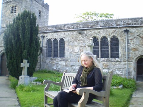 Presenter Christine Finn outside St Michael and All Angels, Hubberholme