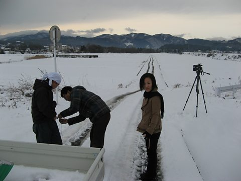 Presenter Mariko Oi prepares to interview a local carrot farmer