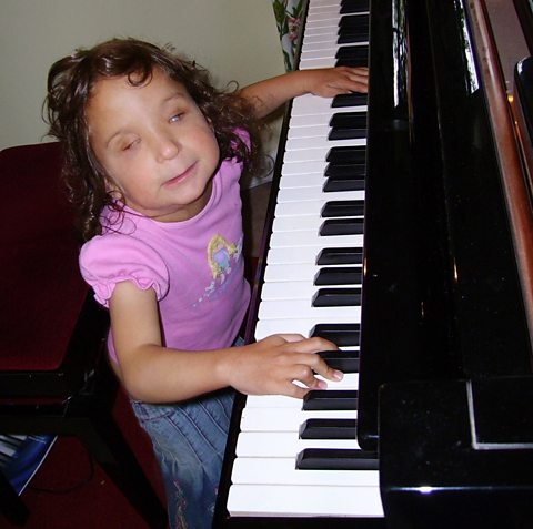 Faith plays the piano
