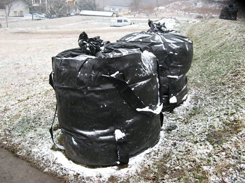 Bags of low level contaminated soil and vegetation
