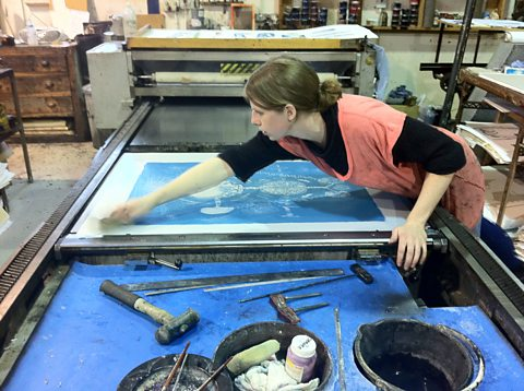 Mary, the print assistant at the Curwen cleaning the on the lithographic press