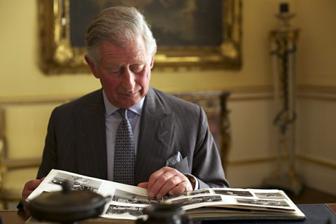 HRH The Prince of Wales reviewing The Queen's photograph albums at Buckingham Palace