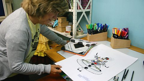 Lucy gets a sneak preview of the drawing for the Rocinha carnival display in the 2009 rio carnival