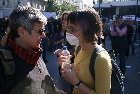Presenter Maria Margaronis interviewing in Syntagma Sq on day 2 of the General Strike, Athens