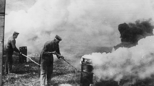 German soldiers stand downwind as they release poisonous gas