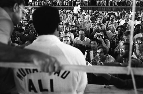 Ali in front of reporters