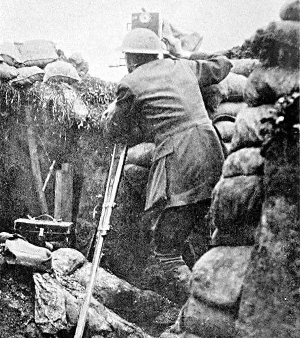 Geoffrey Malins filming in a trench