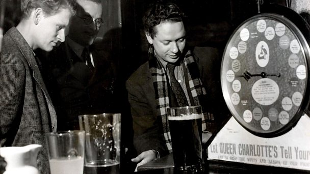 Dylan Thomas enjoying a game of shove halfpenny in January 1946