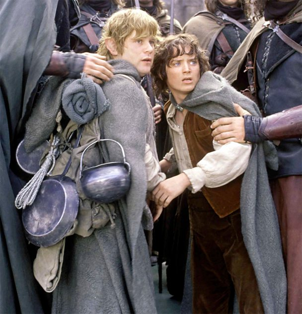 Sam Gamgee (left), Frodo's batman, with their cooking equipment attached to his pack.