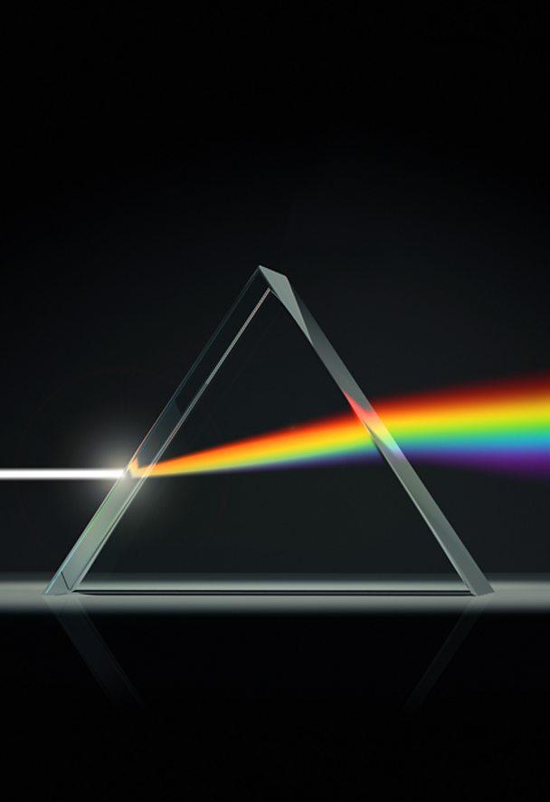 Prism splitting light into color spectrum (credit: artpartner-images / Getty)