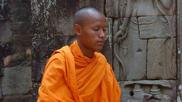Buddhist monk meditating at Angkor Wat, Cambodia