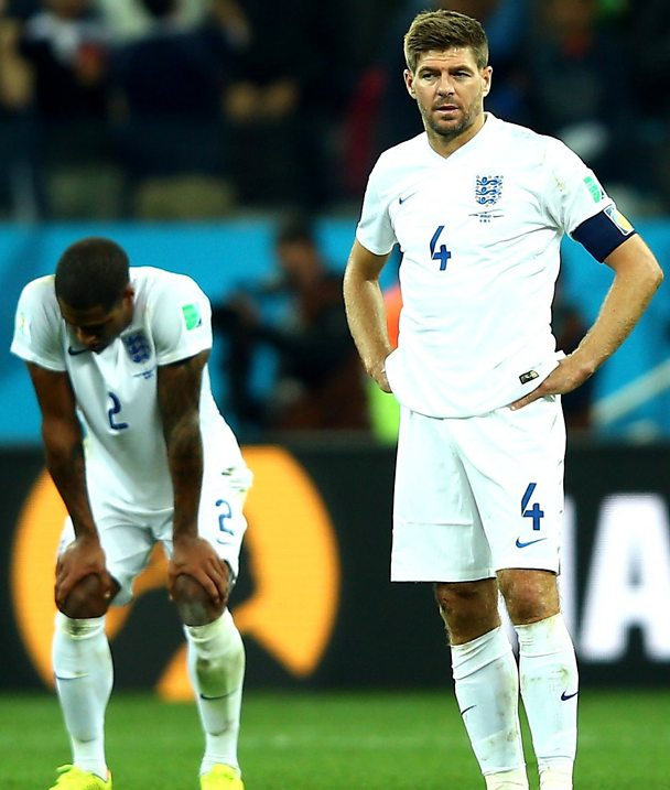 Glen Johnson and Steven Gerrard after England are knocked out of the World Cup