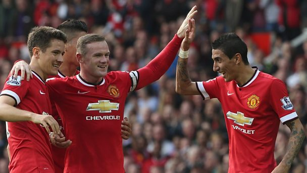 Manchester United's Wayne Rooney (centre) with Angel Di Maria (right) and Adnan Januzaj