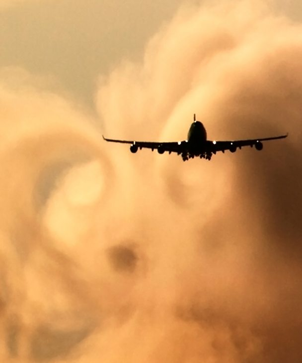 A plane flying through the clouds - Getty Images.