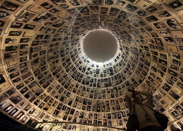 A tourist visits the Hall of Names where names and photos of Jews killed by the Nazis