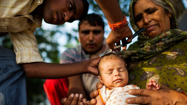 Hindus shave the head of a baby as part of a religious tradition - Getty Images.