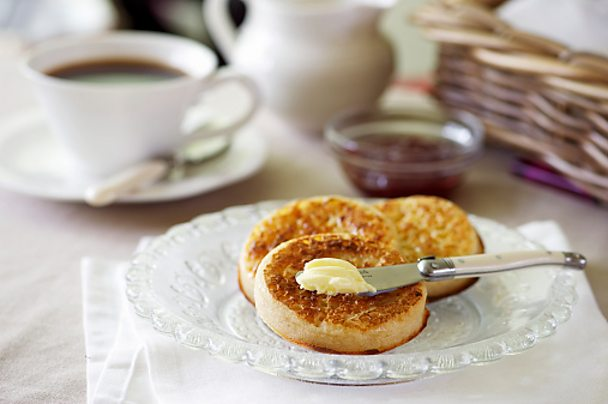 Crumpets with butter and jam