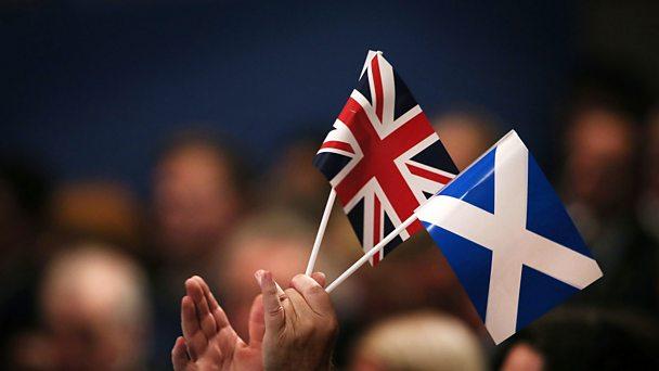 The Union Jack and Scottish flags held aloft