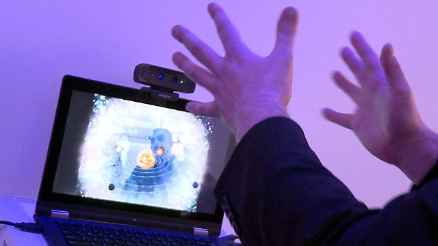 A man controlling a computer through gestures