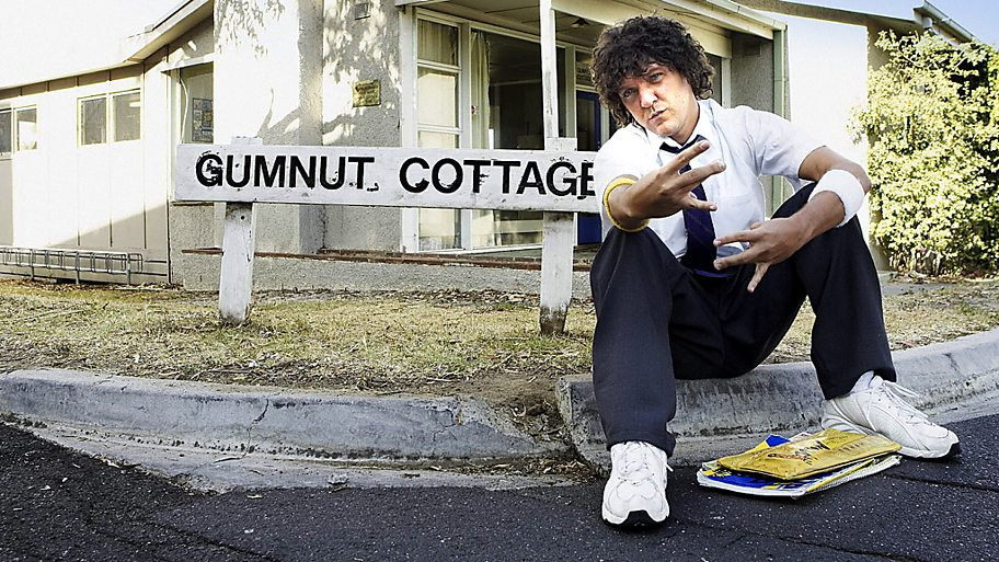 Jonah outside school building of Summer Heights High