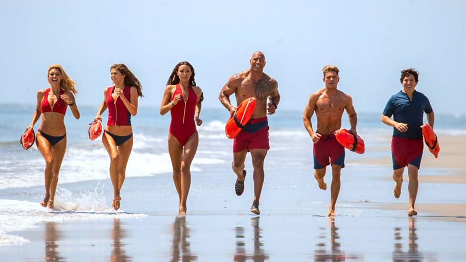 Baywatch cast running down the beach