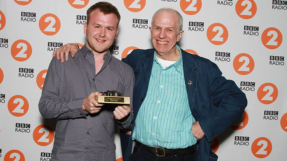 Musician Of The Year winner Sam Sweeney, with presenter John Kirkpatrick