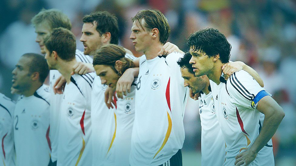 The Germany team prepare for penalties