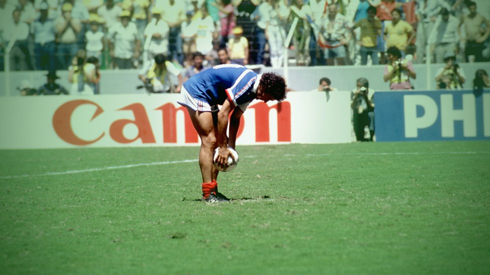 Michel Platini places the ball before taking a penalty in 1986