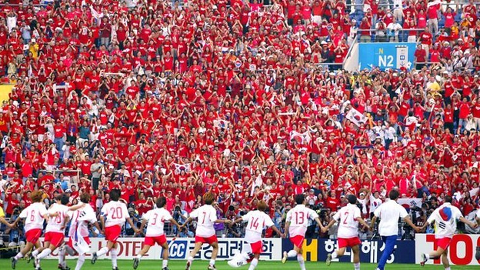 South Korea celebrate in front of their fans after beating Spain in a shootout in 2002