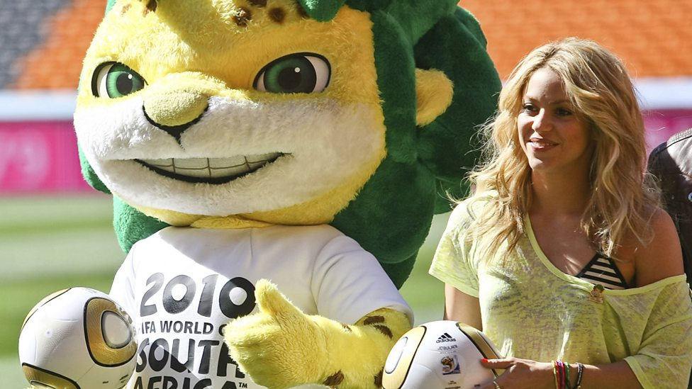 Pop star Shakira, singer of the official 2010 World Cup song, poses with mascot Zakumi.