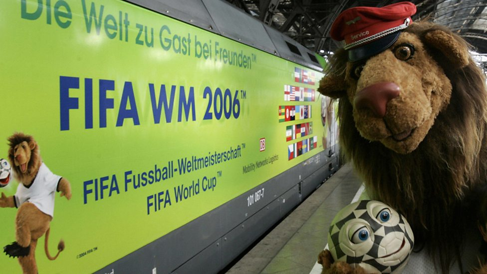 The mascot for the 2006 World Cup in Germany poses as a train driver.