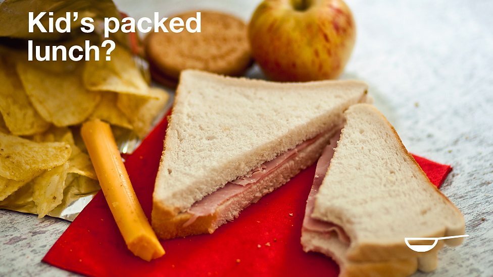Ham sandwich, crisps, cheese and biscuits