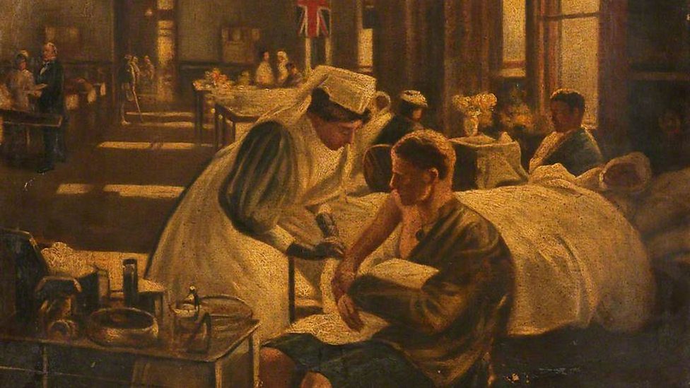 A Nurse Tends a Soldier's Arm while Other Soldiers Lie in Bed by John Lavery